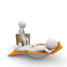Zwei Menschen in einer Therapiesitzung